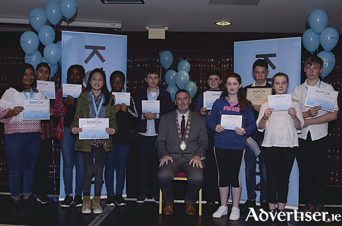 Higher level maths students who received their awards from Deputy Mayor Cllr Michael Cubbard at the recent Kumon awards ceremony. From left: Catherine Jose (dual subject medallist), Samad Kaleen (silver medal), Beulah Ojehonmon, Lexine Estremera (bronze medal), Naomi Adun (special merit award), Joseph Ryan, Deputy Mayor Cllr Michael Cubbard, Stephen Murphy (dual subject medallist), Ciara O'Neill, Hugh McDonagh (special merit award), Maya Saoirse Tutty Kelly, and Justin Mitchell Ward ( silver medal).
