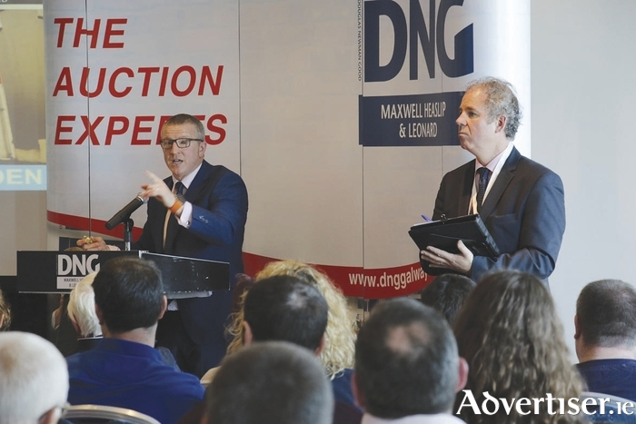 Auctioneer James Heaslip and Fergal Leonard at Friday's auction.