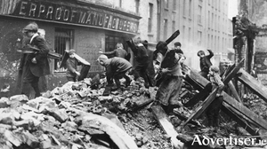 Children playing in the rubble of the ruined Dublin city centre at Easter 1916