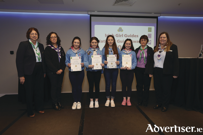 Members of Cairde Girl Guides, Carnmore, pictured at the Irish Girl Guides' national guide awards in Croke Park. From left: IGG president Maureen Murphy, Cairde guide leader Anita Naughton Clarke, Aibhe Berry Howard, Shauna Freeney, Aoife Clarke, Alyssa Laffey, Cairde guide leader, Anne Sture, and IGG chief commissioner Helen Concannon.