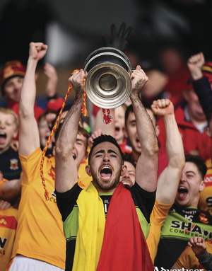 Three of the best: Castlebar Mitchels captain Rory Byrne lifts the Moclair Cup. Photo: Sportsfile