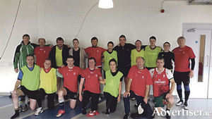 Athlone (yellow/black) and Donnybrook (red) after last Saturday's match at AIT