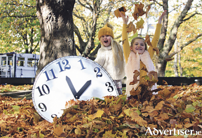 Annabelle Edwards (5) and Abbie Kilbane (7) reminding you to turn the clocks back on October 29. Photo: Gareth Chaney Collins