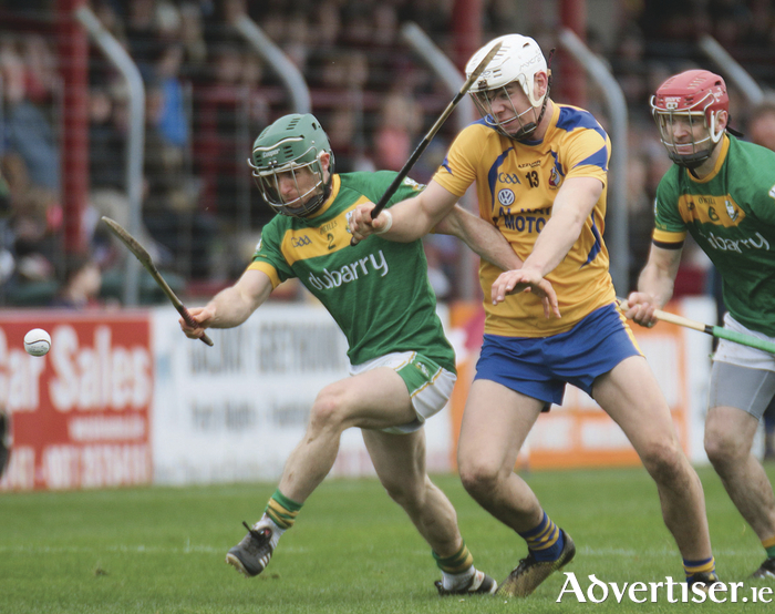 Craughwell's Gerard O'Halloran holds off Portumna's in action from the Galway Senior Hurling Club quarter finals at Kenny Park, Athenry on Sunday. Photo:- Mike Shaughnessy