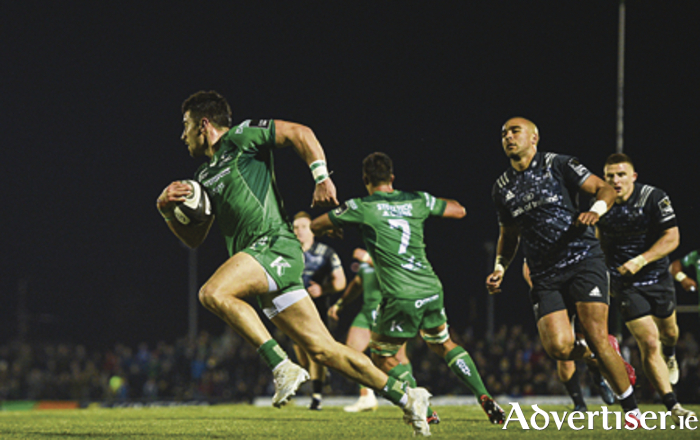 Tiernan O' Halloran on his way to scoring his side's first try during the Guinness PRO14 round seven match between Connacht and Munster at the Sportsground in Galway.