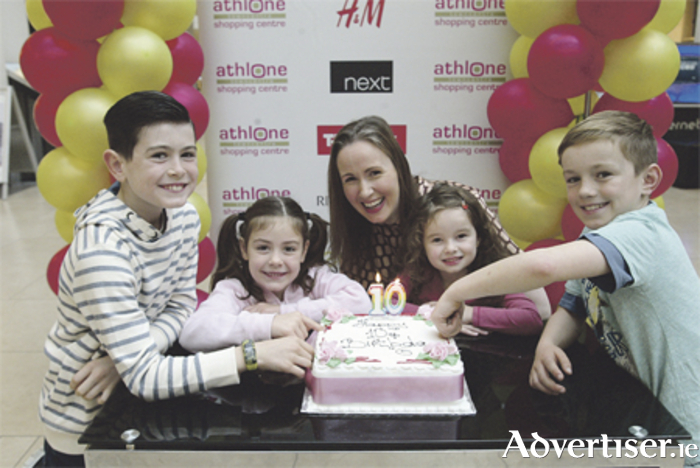 Paul, Aoibh O' Sullivan, Shirley Delahunt, Ruby Flanagan, and James Derwin launching the 10th year opening anniversary of Athlone Town Shopping Centre on Tuesday morning. Photo: Eric Molloy