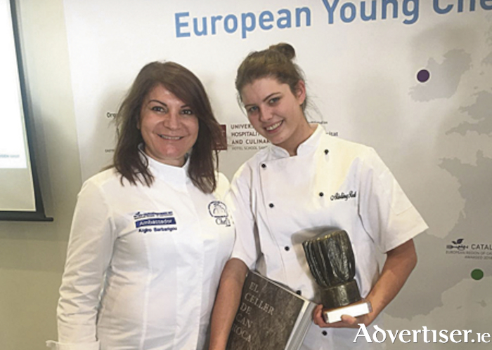 Aisling Rock is presented with her award by Greek celebrity chef Argiro Barbarigou from the famed Papadakis restaurant in Athens.