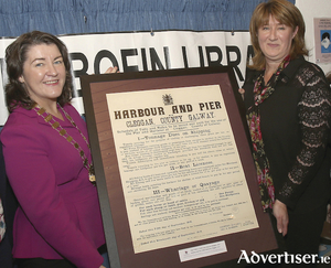 Cathaoirleach of County Galway, Cllr Eileen Mannion presents Audrey Murray (Inishbofin Public Library) with a duplicate copy of a 1916 public notice relating to the tolls and rates associated with the Cleggan pier.