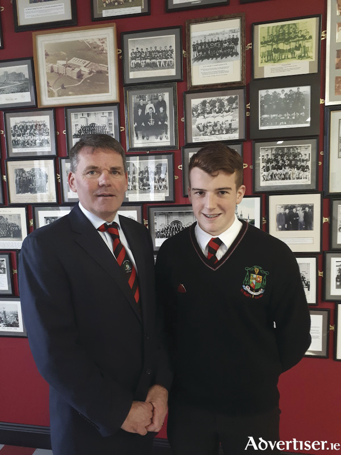 Tom Nolan, principal, St Mary's College, presents Paul Conneely with his head prefect badge.