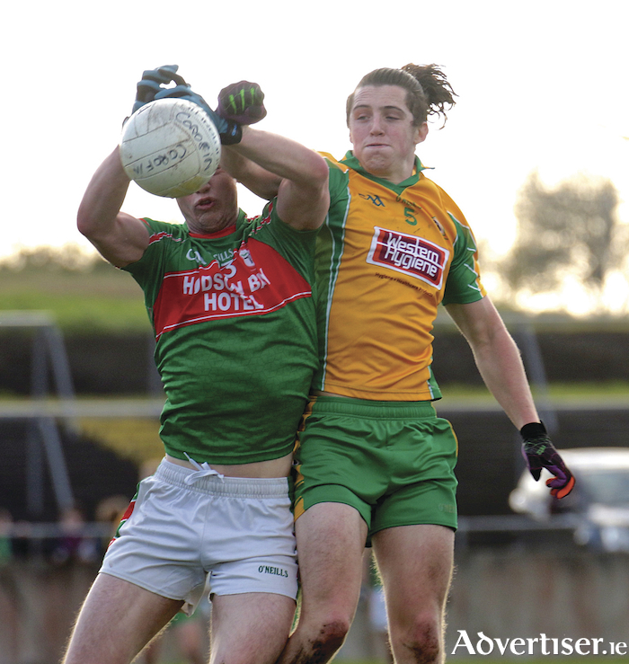 Kieran Molloy of Corofin and Peter Domican of St Brigid's in action from the Connacht GAA  Club Senior Football championship semi-final at Tuam Stadium on Sunday. Photo:-Mike Shaughnessy