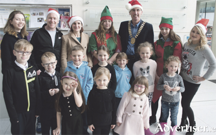 Children from the Mary Fox Stage & Drama School and the Bronte Fitzmaurice Stage & Drama School with Bronte Fitzmaurice, Joe McCaul, Caoimhe O'Connell, Elf Rachel Nally, Mayor Aengus O'Rourke, Elf Kate Nally, and Michaela Hayes of iRadio