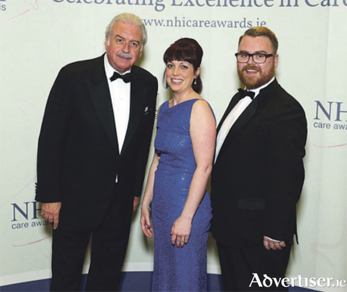 Clare McNally and John Berry are pictured with broadcaster Marty Whelan, who was MC for the awards night. Photo: Maxwell Photography