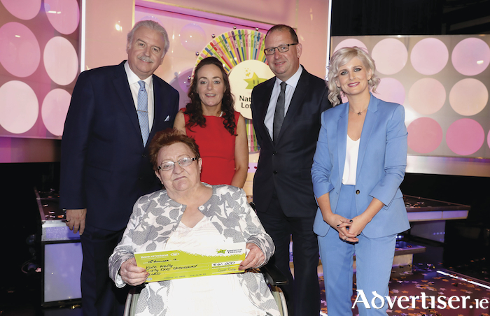 Kate Kelly from Kilmaine won €61,000 including a holiday to Venice, Italy on last Saturday's National Lottery Winning Streak Game Show on RTE. Pictured here at the presentation of the winners cheques were from left to right: Marty Whelan (Winning Streak game show co-host) Kate Kelly the winning recipient; Marian Connell - Kates daughter who played on Kate's behalf; Niall Andrews (Head of Sales at the National Lottery) and Sinead Kennedy (Winning Streak game show co-host). The winning ticket was bought from Hollymount Store, Hollymount. Photo: Mac Innes Photography