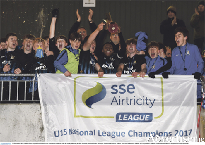 Athlone Town captain Israel Kimazo and team-mates celebrate with the trophy. Photo: Stephen McCarthy/Sportsfile