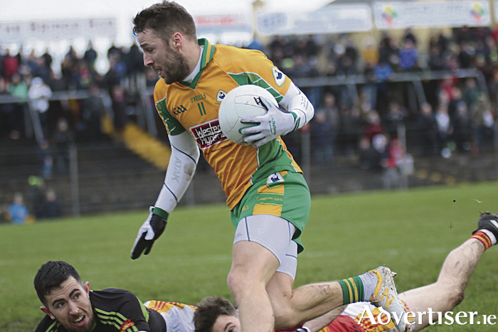 Corofin's Michael Lundy rounds Castlebar Mitchell's goalkeeper Rory Byrne to score a goal in the Connacht GAA Club Senior Football Championship final at Tuam Stadium, Sunday. 					Photo:-Mike Shaughnessy