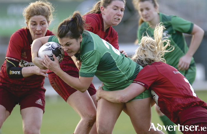 Connacht's Jane O'Neill is tackled by Munster captain Siobhan Fleming in action from the Women's Rugby Interprovincial game at the Sportsground on Saturday.  Photo:-Mike Shaughnessy
