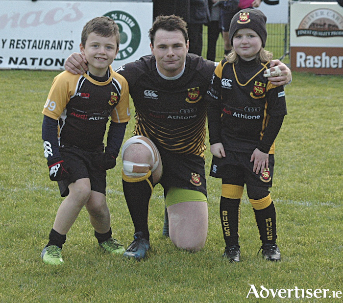 Buccaneers captain Shane Layden with mascots Fionn Cotton and Sarah McCormack