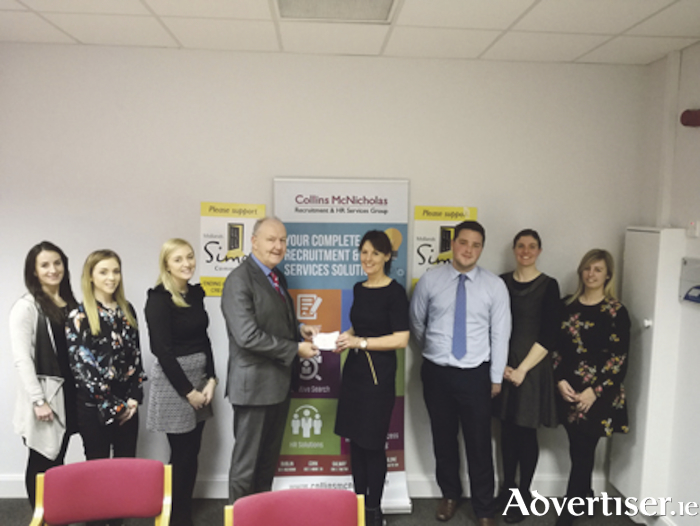 The Athlone Collins McNicholas' team handing over a cheque to the Simon Community: Emma Woods, Denise Callinan, Nicola Egan, Noel Greene of Midlands Simon Community, Mary Mullin, Eoghan Dalton, Caroline Ward, Tina Egan. Missing from photo: Gillian Nicholson and David Lennon