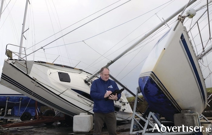 The aftermath of Eleanor's visit. Loss adjuster Pat McCormack assesses the damage to yachts battered by Storm Eleanor at the Quay in Westport this morning.  Photo: Paul Mealey.