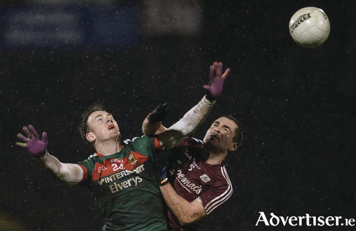Up and under in the rain in MacHale Park. Photo: Sportsfile