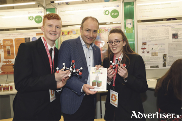 Fianna Fáil leader, Micheál Martin is pictured with Theresa Hamm and Jack O'Donovan from Moate Community School at the BT Young Scientist Exhibition. Photo: Conor McCabe Photography