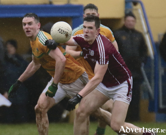 Galway's Cein D'Arcy and Leitrim's Eoin Ward in action from the FBD Connacht League game at Clonbur on Sunday.  Photo:-Mike Shaughnessy