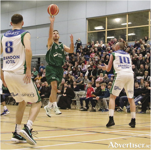 Moycullen captain James Loughnane shoots against Tralee's Darragh O'Hanlon and Kieran Donaghy in action from the Basketball Ireland  Superleague  game at Kingfisher NUI Galway on Saturday night. Photo:-Mike Shaughnessy