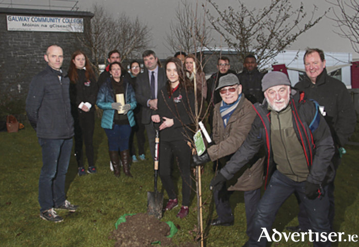 "Right: Holocaust survivor Tomi Reichensthal and Gerry Gregg director of the ""Condemned to Remember"" documentary were at Galway Community College on Tuesday for a brief tree planting ceremony for remember Holocaust victims. Tomi was helped by GCC student Wiktoria Gorczytca whose great grandfather was imprisoned in Auschwitz, Buchenwald, Sachsenhausen and Dachau, and amazingly survived. 