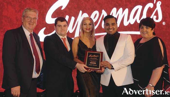 Pat and Úna McDonagh present the Outlet of the Year Award to Aaron Fahy Chanel Gavigan and store manager, Zaheer Ahmed of Supermac's Tuam Rd at the Supermac's All Star Awards in the Loughrea Hotel and Spa on Tuesday night.