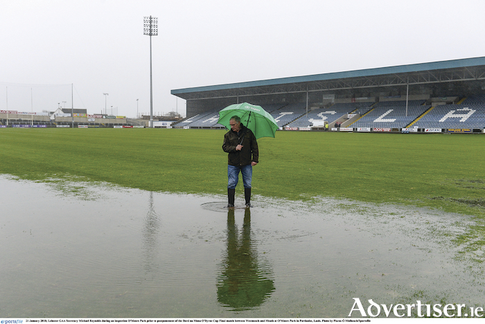 Leinster GAA secretary, Michael Reynolds is pictured inspecting a waterlogged O'Moore Park prior to the postponement of the Bord na Mona O'Byrne Cup final between Westmeath and Meath last weekend. Photo: Piaras O Midheach/Sportsfile