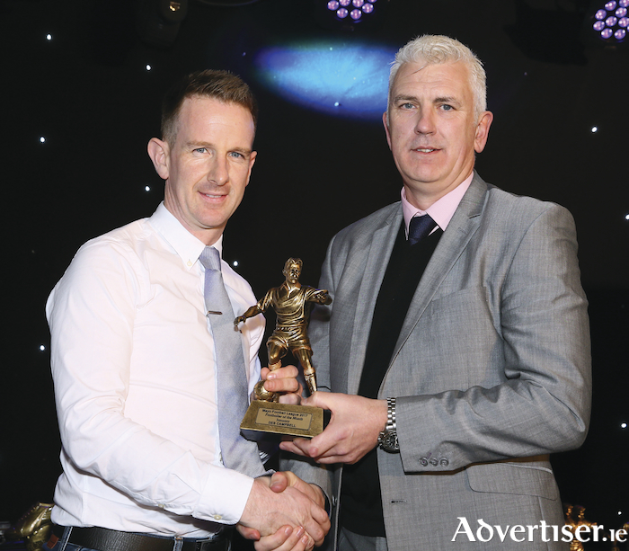 Des Campbell, Manulla is presented with the January Player of the Month in Masters Division One by James Larkin from the  Mayo League at the Mayo Football League Annual presentation Dinner and Awards Night in the Castlecourt Hotel Westport. Photo: Michael Donnelly