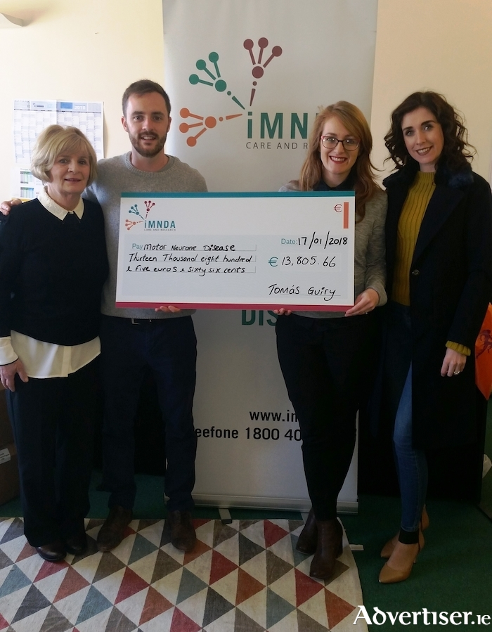 Martha Guiry with son Tomás, daughter Fiona, and daughter-in-law Aoife presenting the cheque to staff in the Irish Motor Neurone Disease Association office.