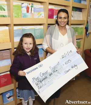 Six-year old Clara Kelly from Parke, Castlebar presenting a cheque to Trisha Greavy, General Manager of Mayo Cancer Support, Rock Rose House for ?605. Clara recently cut 16 inches off her hair and donated it to The Rapunzel Foundation and also raised money the local Cancer Support Centre. Photo: Michael Donnelly
