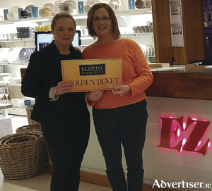 Melissa Casserly from EZ Living Terryland presents Noirin Ui Ghoill with her prize.