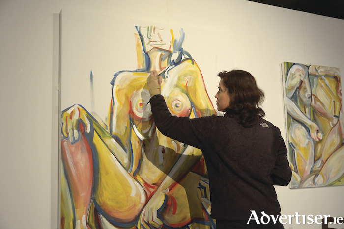 Artist Margaret Nolan at work on paintings for the Skin exhibition. Photo: Jamie Howard