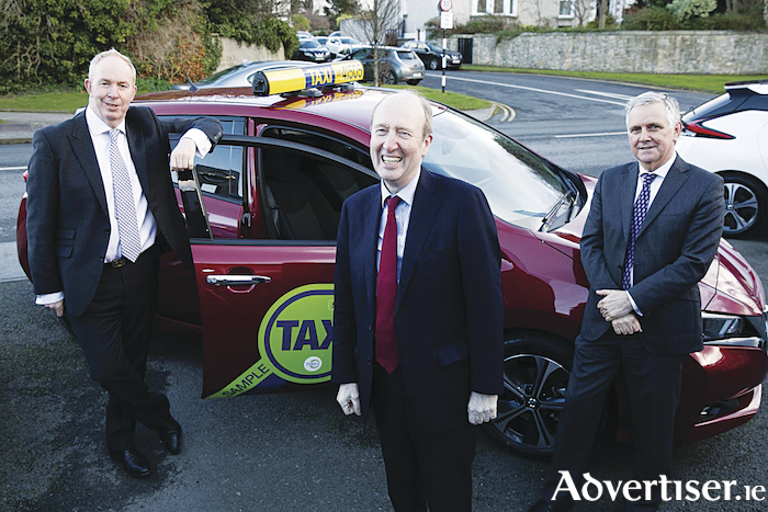James McCarthy from Nissan, Transport Minister Shane Ross, and Alan Nolan from the SIMI.