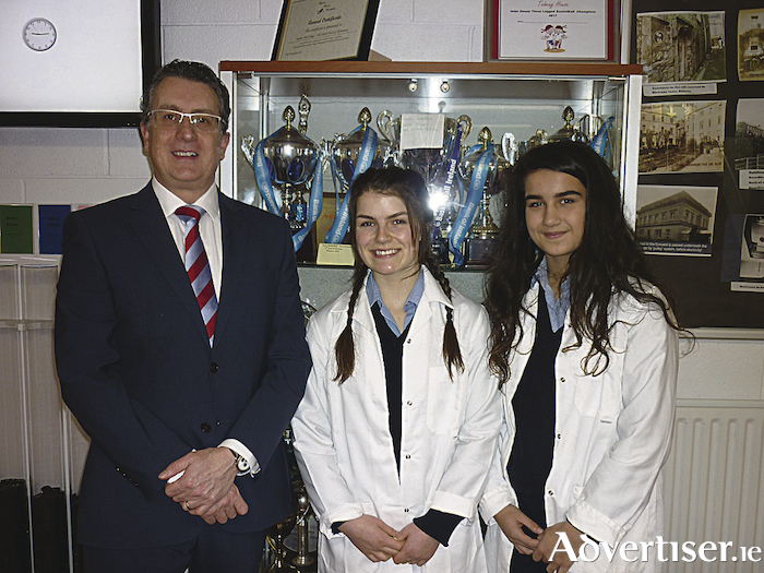 Second year students Aaliyah Clohessy and Ava McGahon represented Dominican College, Taylor's Hill, at the BT Young Scientist Exhibition where they presented an app called ReWire which enhances the attention span of  students while studying. Also in the photo is the principal of Dominican College, Alan Kinsella.