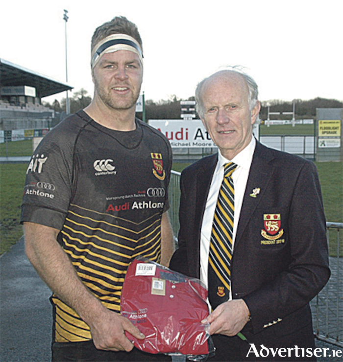 Daniel Law is presented with the Audi Athlone Man of the Match Award by Buccaneers president, Tom Meagher