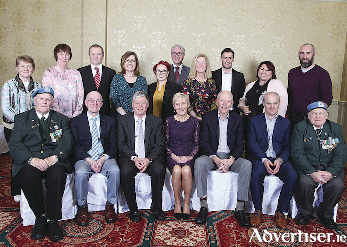 At the launch of Galway People of the Year Awards back row L-R: Catherine Corless, Marie Cahill, Joe Hansberry, Karen Mannion, Keara McDonald Sheeran, Morris O'Gorman, Evelyn O'Toole, David Burke, Olive Dermody Shaughnessy, John Muldoon; front row L-R: Charles Cooley, Pádraig Ó Beaghlaoich, Ollie Robinson, Caroline Rushe, Iggy Ó Muircheartaigh, Micheál Donoghue and Seán Flynn. Photo Sean Lydon