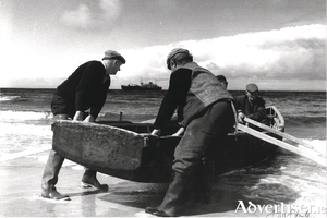 Inis Óirr - Bringing a Currach Out. Photo:- Bill Doyle
