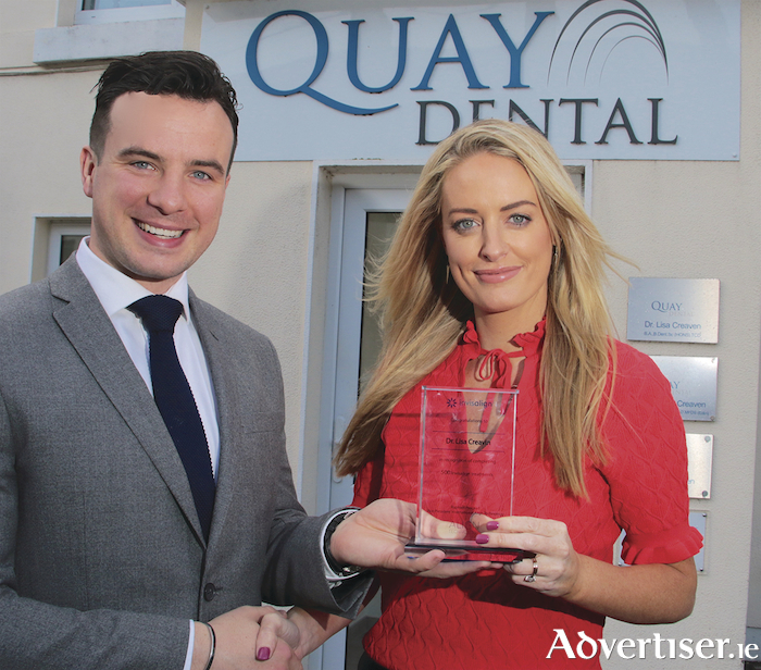 Peter Duffy area sales manager of Invisalign  Clearbraces presenting Lisa Creaven with an the award for completing one thousand cases at Quay Dental, Woodquay, on Tuesday. Photo: Mike Shaughnessy.