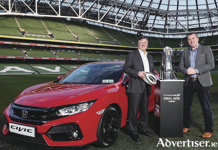 Honda Ireland has become the official car partner of this season's Guinness PRO14 final series. Pictured with the new Honda Civic and the PRO 14 trophy are Adrian Cole, managing director of  Universal Honda Ltd, and Dermot Rigley, commercial and marketing director of  PRO14 Rugby, in the Aviva Stadium.