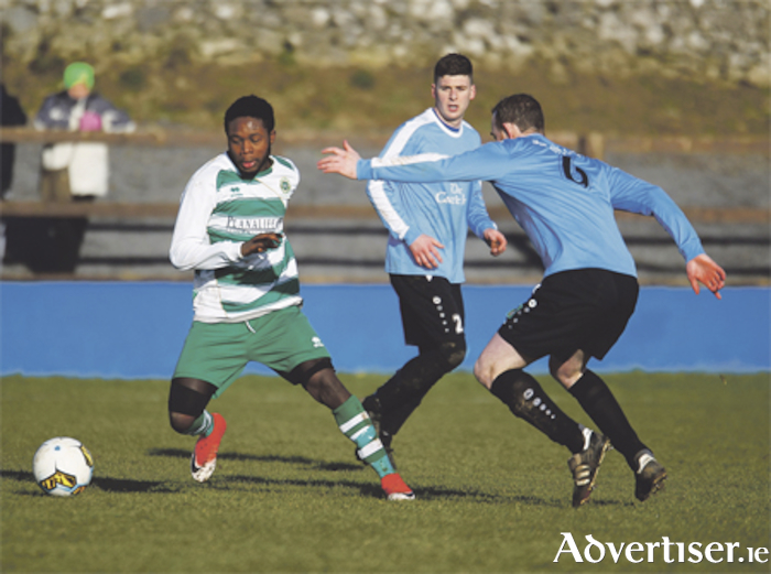 Henry Ethiosa Odia gets away from Moore United captain Paul Kelly. Photo: Ashley Cahill/AC Sports Images