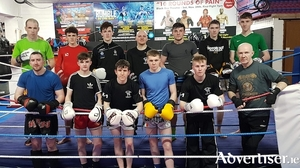 The Galway Black Dragon fighters ready for action after their last heavy sparring session.Back row, Tom Scarry (Moylough/Ballybane), Eoin Mulvihill (Ballinfoyle), Cian McCormack (Kinvara), Dara Mannion (Westside), James Kelly (Athenry), Corey O Malley (Ballybrit), Alex Fitzpatrick (Tuam).Front row: Adam Keane (Abbeyknockmoy), Ben Devlin (Knocknacarra), Sean Ryan (Cong), Damien Creavin (Ballybrit), Cian Doherty (Headford) and head coach Pete Foley. (Annaghdown).