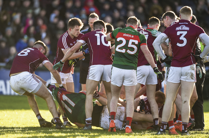Drag back: Galway's Paul Conroy drags Aidan O'Shea along the ground last Sunday in Satlhill. Photo: Sportsfile.