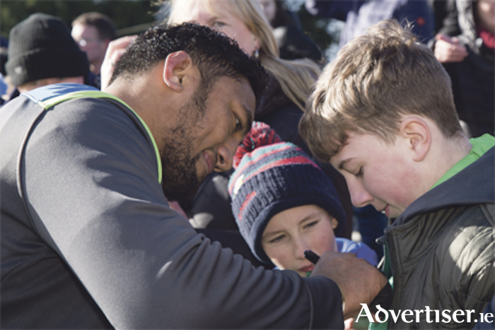 Bundee Aki signing shirts for Sean Donohoe and Conor Dowling