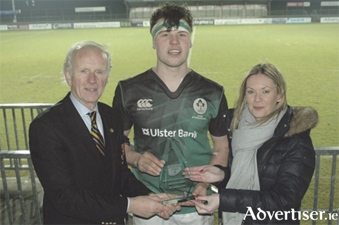 Ireland Club's Michael Melia is presented with the Man of the Match Award by Elaine Dunning of Ulster Bank and Dr Tom Meagher, President of Buccaneers RFC