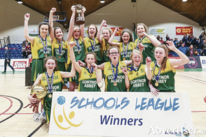 Top of the class: The Gortnor Abbey girls celebrate winning the league title in the National Basketball Arena in Dublin. Photo: Rockmountain Studios