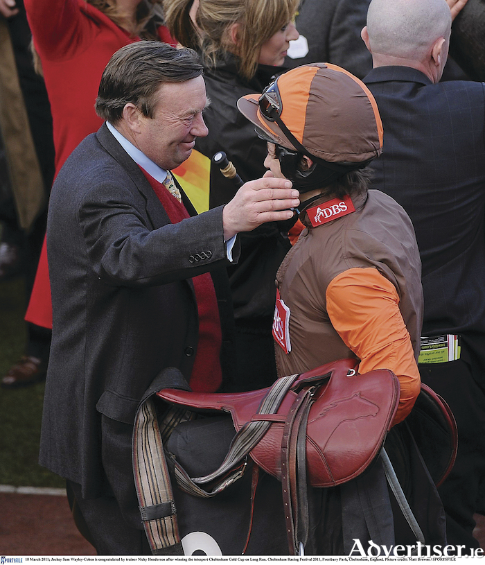 Jockey Sam Wayley-Cohen is congratulated by trainer Nicky Henderson after winning the Cheltenham Gold Cup on Long Run at the  2011 festival.Picture: Matt Browne/SPORTSFILE