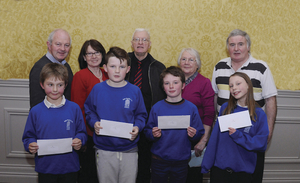 Killeen NS who finished in third place in group A of the Credit Union Chapter table quiz, which was held in the Great National Hotel in Ballina. Back row: Jimmy Murphy (Credit Union), Cathy Murtagh (Credit Union), Michael Gormley (Credit Union, Chapter Treasurer), Theresa Convey (Credit Union) and John Walsh (Credit Uniion). Front Row: Eoin Dyar, Matthew Kilcoyne, Cian O'Malley and Lilly Dunwood.  Photo: John O'Grady Photography.